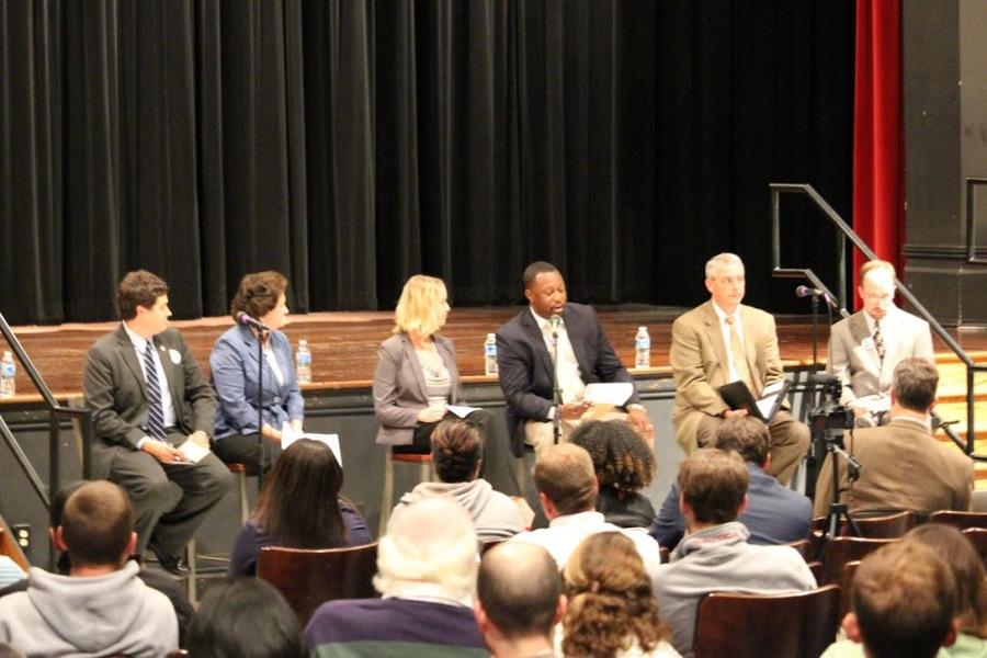 The candidates answering questions at a forum at JMU.