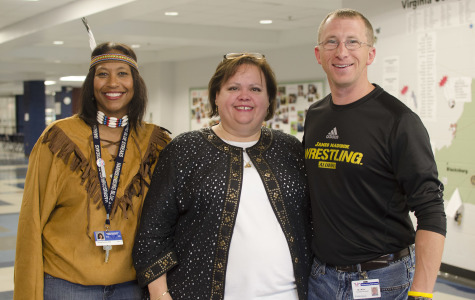 Principal Cynthia Prieto wearing authentic Columbian jewelry and administrators Lesonya Bullard and Eric Miller.