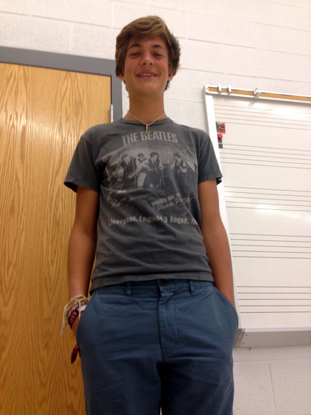 Junior Noah Heie rocks a casually cool look. His Beatles t-shirt doesn't come off as pretentious when it's paired with his perfectly baggy and classy blue cloth pants and patterned vans. The shades of blue match his eyes in just the right way, pulling everything together.