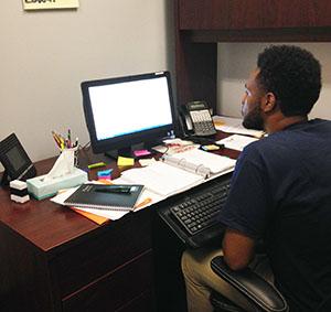 Lamb works at his desk.