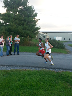 Abrham Amine battles it out for a first place spot at the Fairgrounds 5k course.