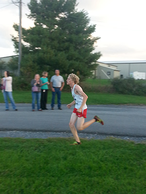Evan Jost uses up everything he has to achieve a personal best time of 17:56.