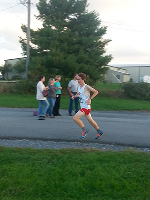 Joel McNett makes his way to the finish of the Fairgrounds 5K course.