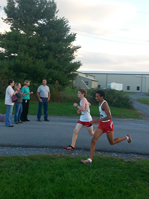 Isaiah King paces Ashton Landes as they approach the finish at the Fairgrounds 5K course.