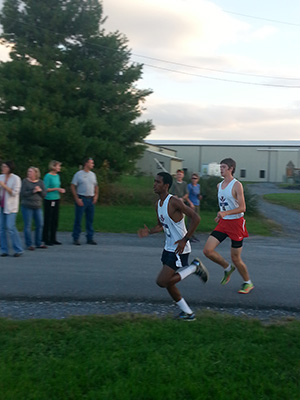 Mehari Gidey and Austin Engle battle it our while approaching the finish line at the Fairgrounds 5k course.