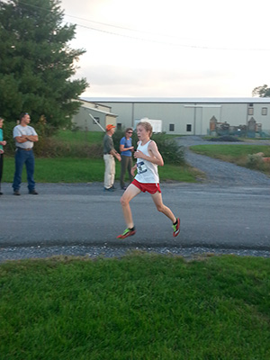 Jacob Blagg strides toward the finish line on the Fairgrounds 5K course.