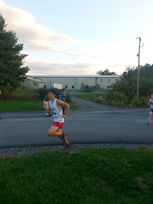 Tyler Rodriguez rides it out in style while sprinting towards the Fairgrounds 5k course in a bandana.