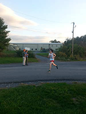 Martin Beck  strides it out toward the finish at the Fairgrounds 5k course with a time of 21:33.