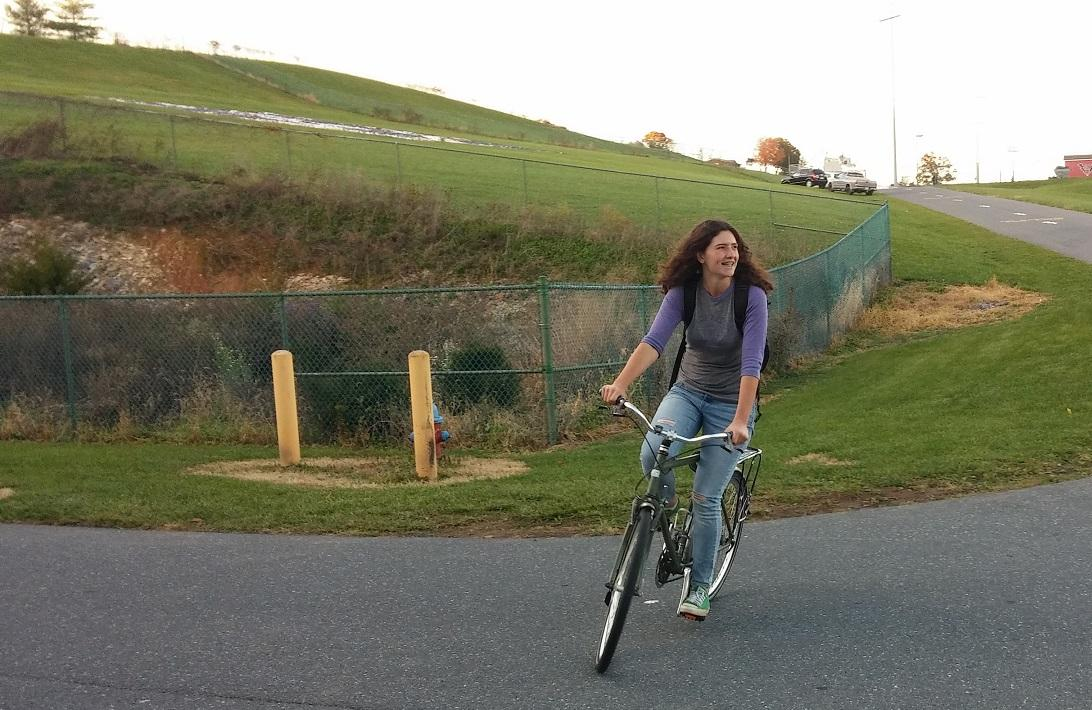 Sophomore Cora Sawin rides her bike home after band practice.