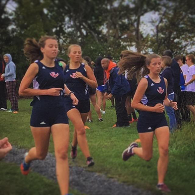 Girls cross country team is off, staying as a pack at the beginning of the race.