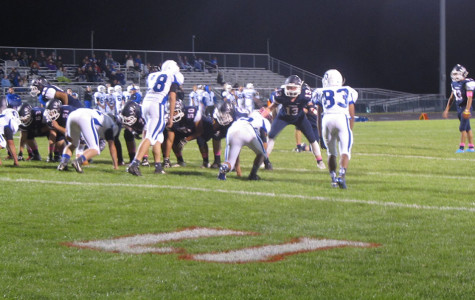 The HHS offensive line prepares to block for the extra point kick.
