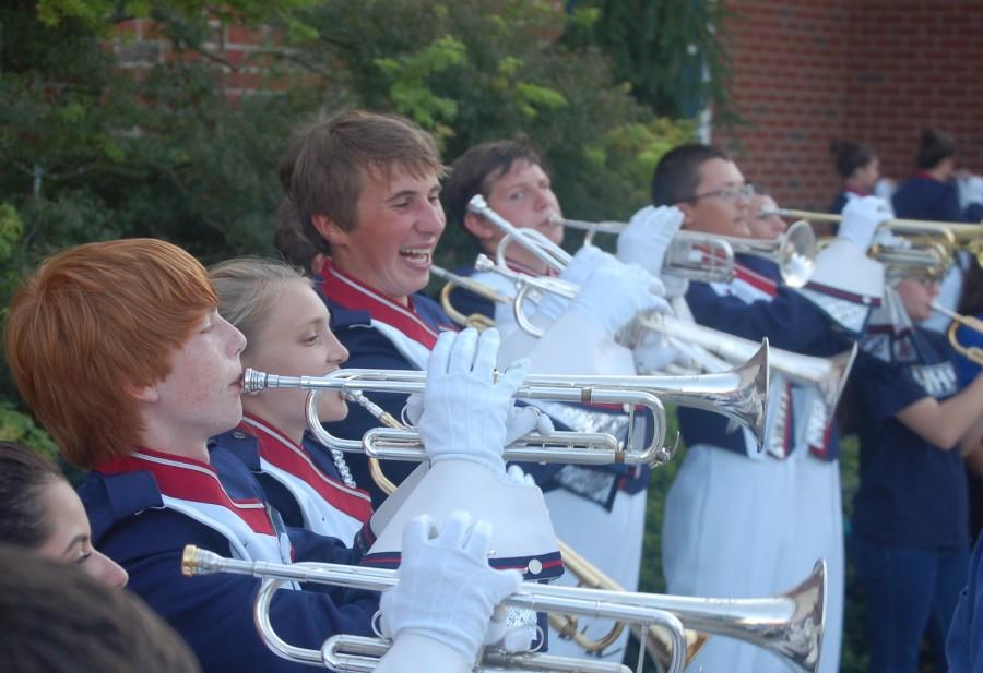 Members+of+the+trumpet+section+participate+in+the+warmup+before+the+marching+band+performance+at+a+friday+night+football+game.+