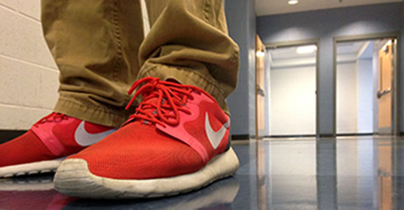 Freshman Walker Thompson wears his red Roshe Runs to school frequently.