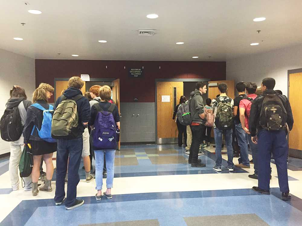 Students wait outside the the auditorium to take the test. The test was soon canceled due to a mistake.
