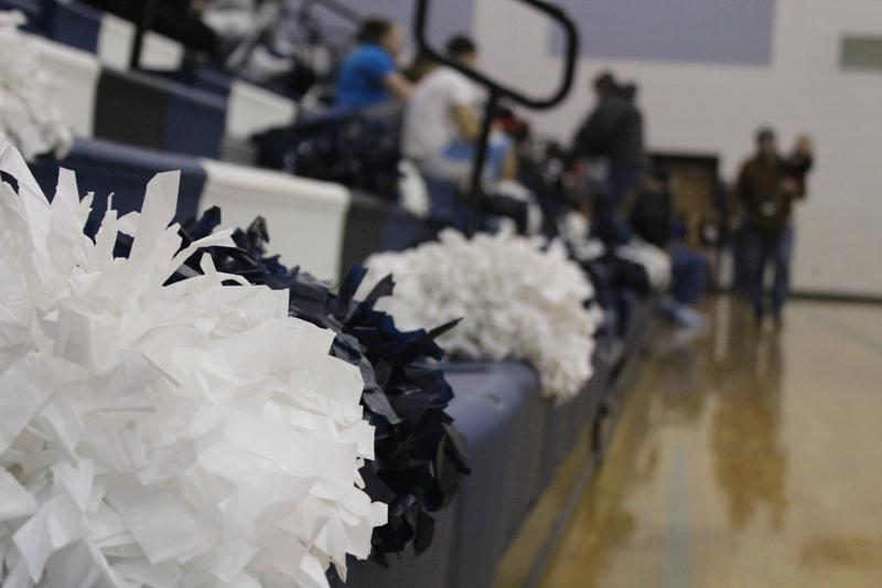 The+sideline+cheer+team%27s+pom-poms+are+lined+up+and+ready+for+use+during+the+home+game.