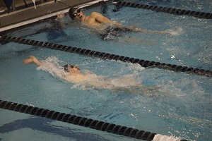 Junior Andrew Rath places 5th in the 100m backstroke event advancing to Regionals.