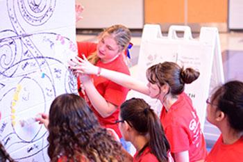 Artist helps with school mural