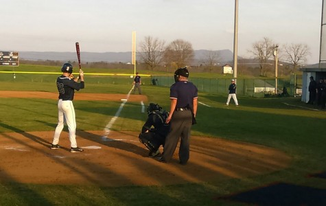 Junior Chandler Hill waits for the pitch to be thrown.