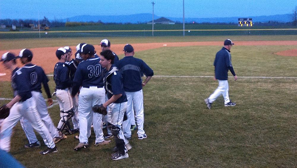 The+varsity+baseball+team+talks+to+each+other+after+losing+their+lead+in+an+inning.