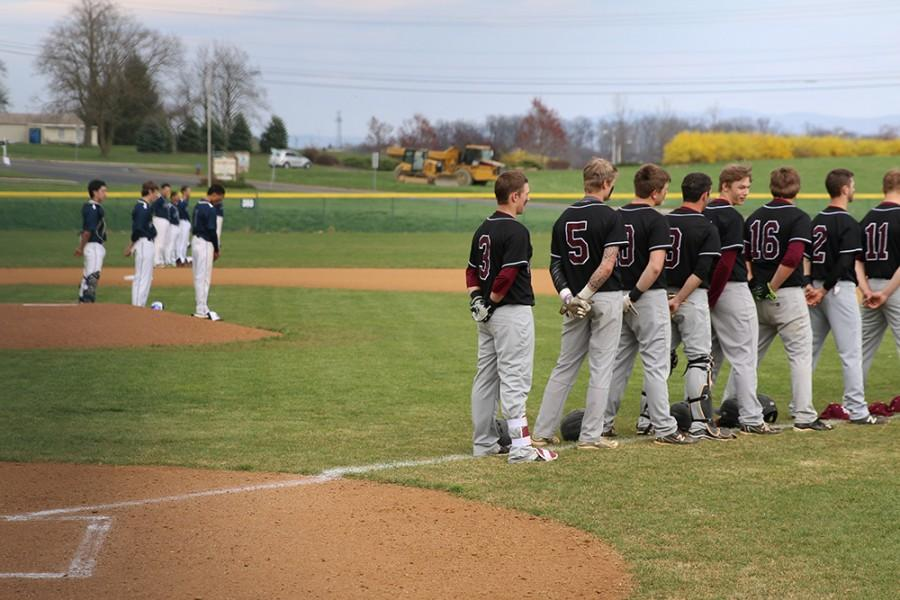 The+Amherst+and+Harrisonburg+varsity+baseball+teams+line+up+for+pre-game+introductions+and+the+national+anthem.+