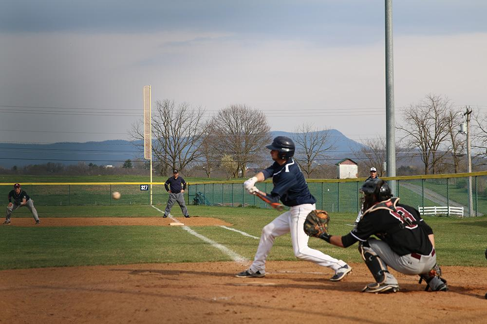 Junior Cade Templeton smacks a base hit in the fifth inning.