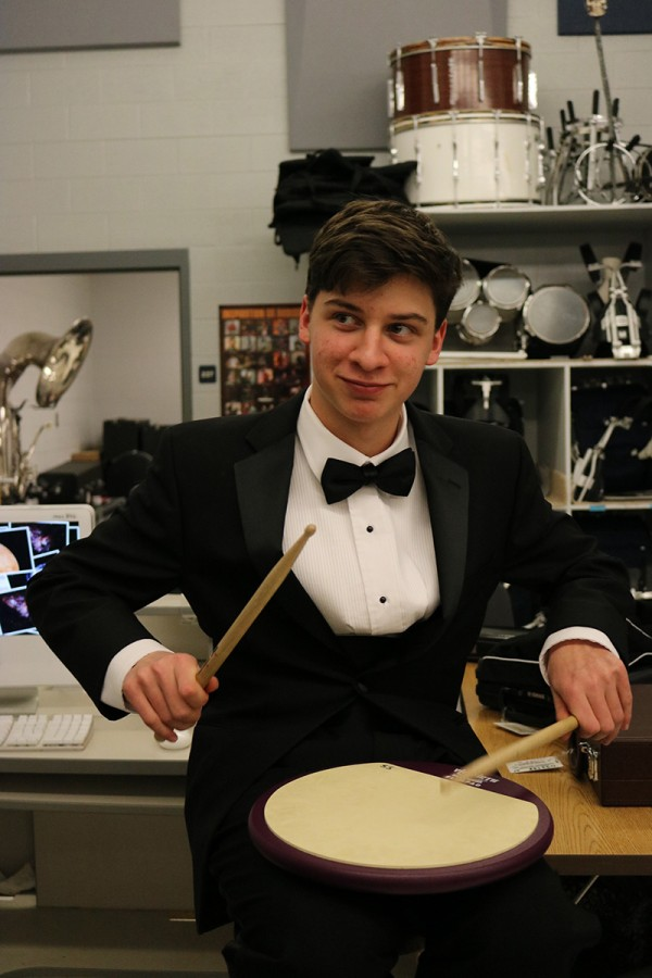 +Freshman+Sam+Schaeffer+warms+up+on+a+drumming+pad+before+the+pre-assessment+concert.+%E2%80%9CBe+intentional+and+practice+so+that+you+don%E2%80%99t+get+into+Percussion+1+and+you+get+into+Percussion+2+because+that%E2%80%99s+where+the+real+pros+are+at%2C%E2%80%9D+Schaeffer+said.