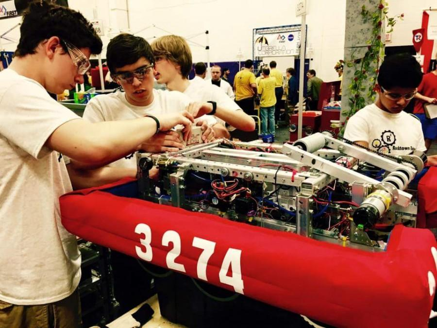 Junior Tyler Rodriguez fixes an issue with the robot after competing..