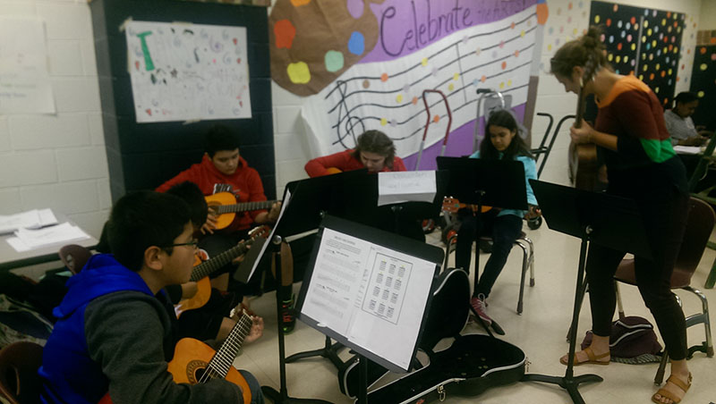 The Thomas Harrison Middle School guitar club performs at the electives fair.