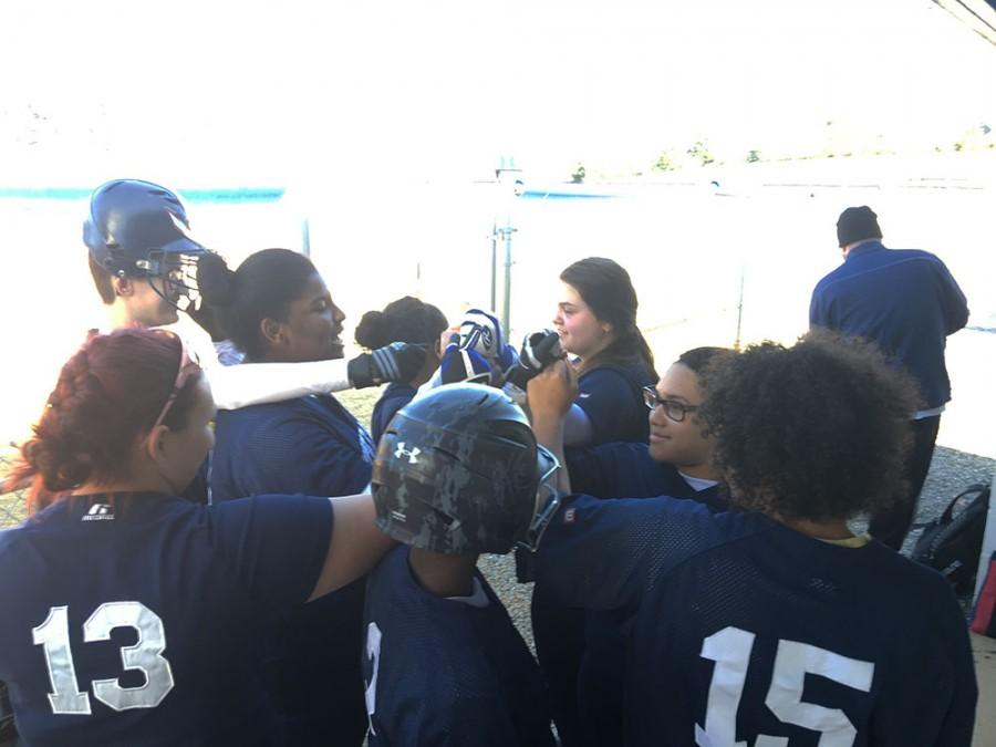 JV+softball+team+breaks+it+down+before+the+game.