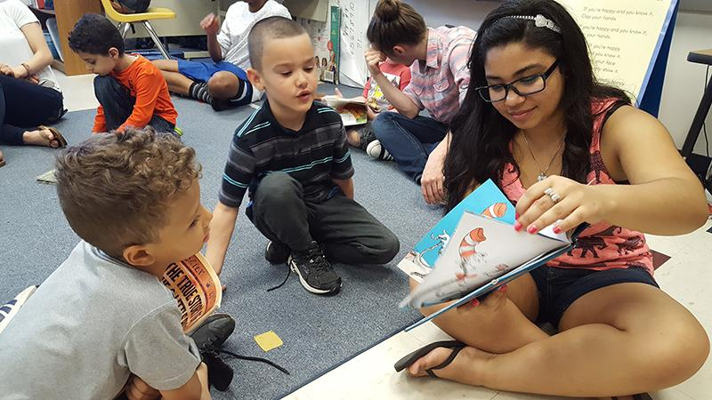 Junior Briana Cheng reads to Waterman Elementary School students.