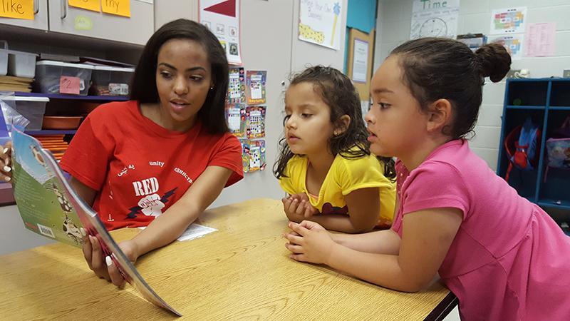 Senior Taylor Maclon reads to Stone Spring Elementary School students.