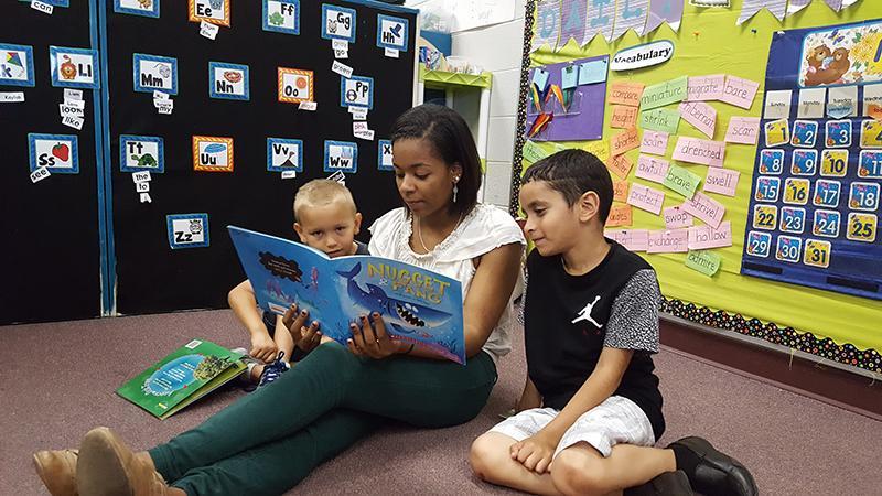 Senior Carrissa Washington reads to Stone Spring Elementary School students.