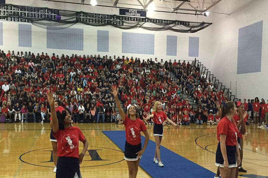 The cheerleaders perform their routine during the pep rally.