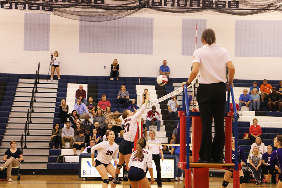 The ball is blocked by the Streaks, earning them a point