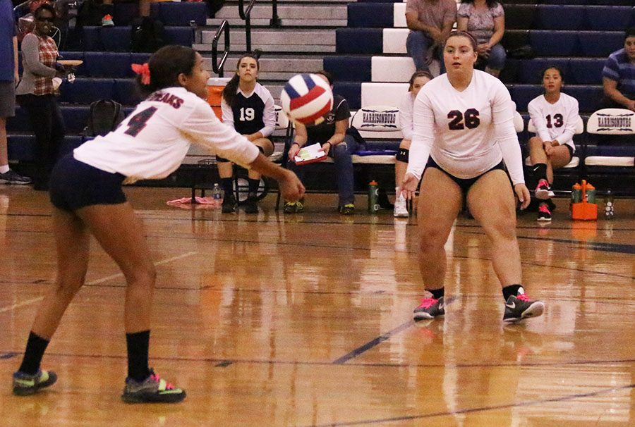 Shadther Rosso-Feliz hits the ball to her teammate Paula Moreira.