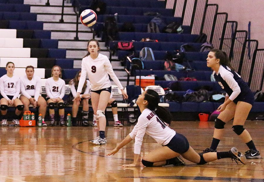 Juliana Lee dives for the ball to keep the volley going.