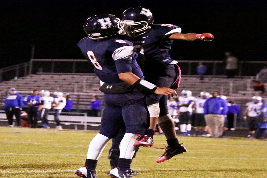Players chest bump after a play