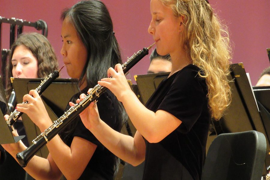 The clarinet section plays along with the rest of the band