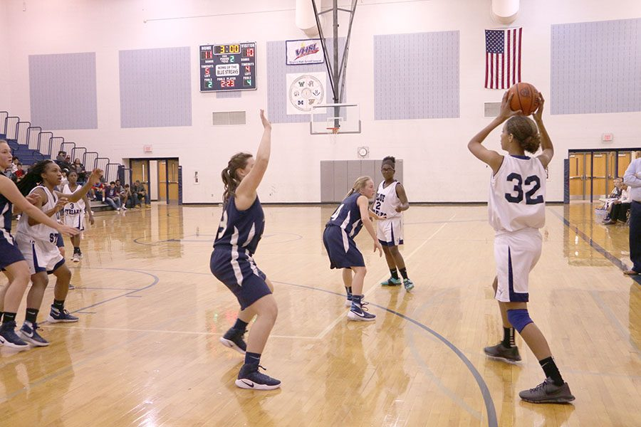 Adaja Bender looks for an open teammate before making a pass.