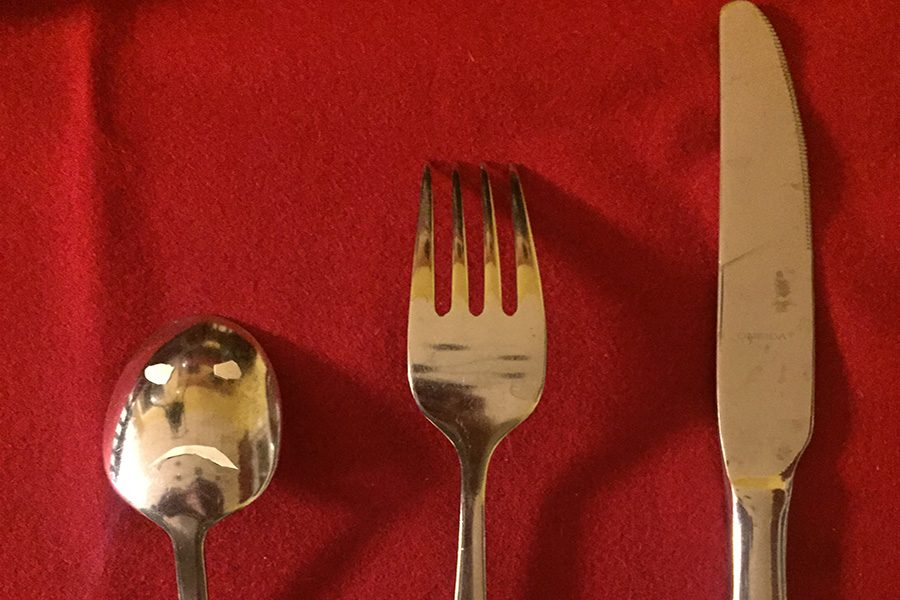 A photo juxtaposing the inferior utensil by the fork and knife.