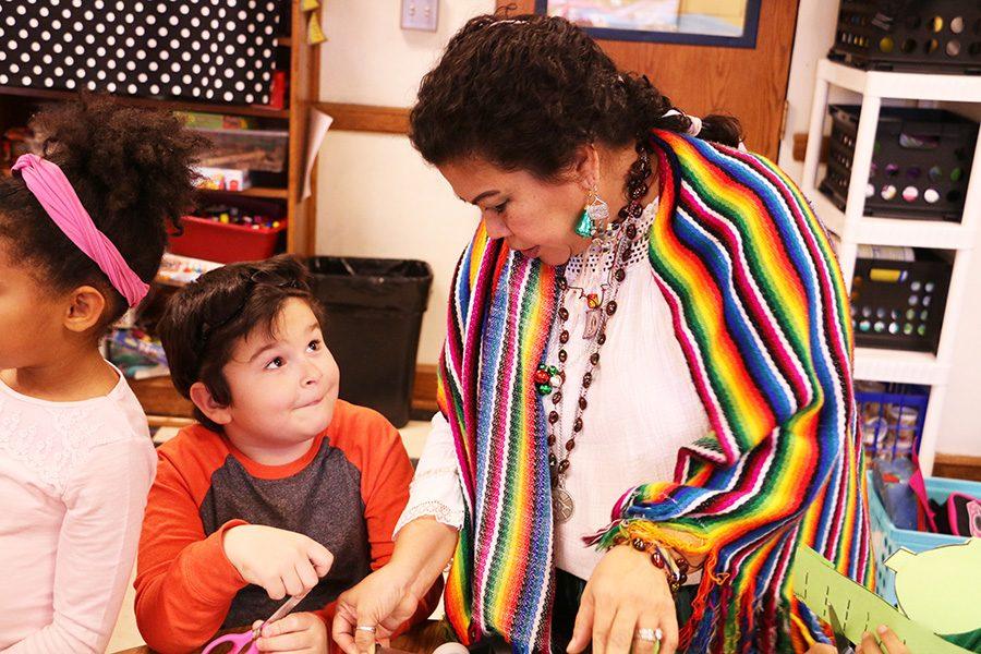Daysi Espinosa educates first grader Benji Elder on la posada, a Mexican holiday tradition celebrating the birth of baby Jesus.