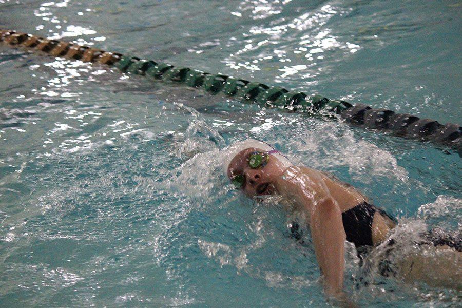 Freshman Andi Fox swims the freestlye