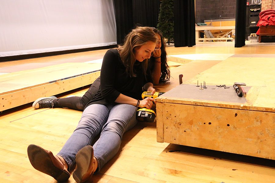 Senior+Megan+Labarge+works+on+the+set+for+the+play
