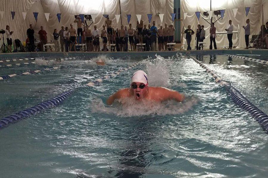Senior Alex Osinkosky performs in the swim meet