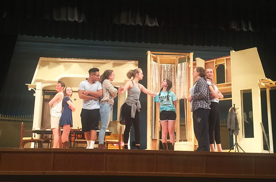 Senior Ana Hart sings 'Whenever I'm With You' along with other cast members in Act 1.