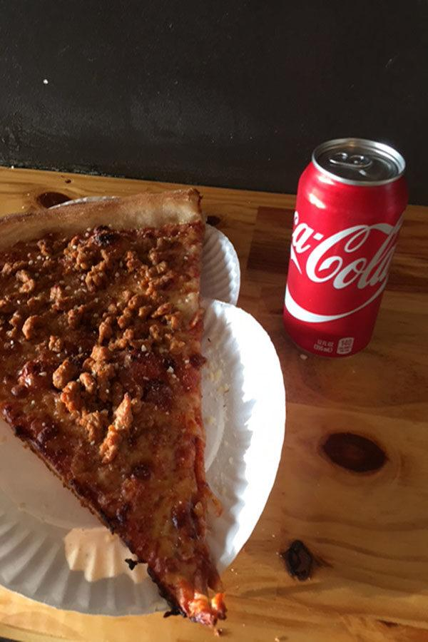 Bennys Pizza beside a can of Coca-Cola for size comparison
