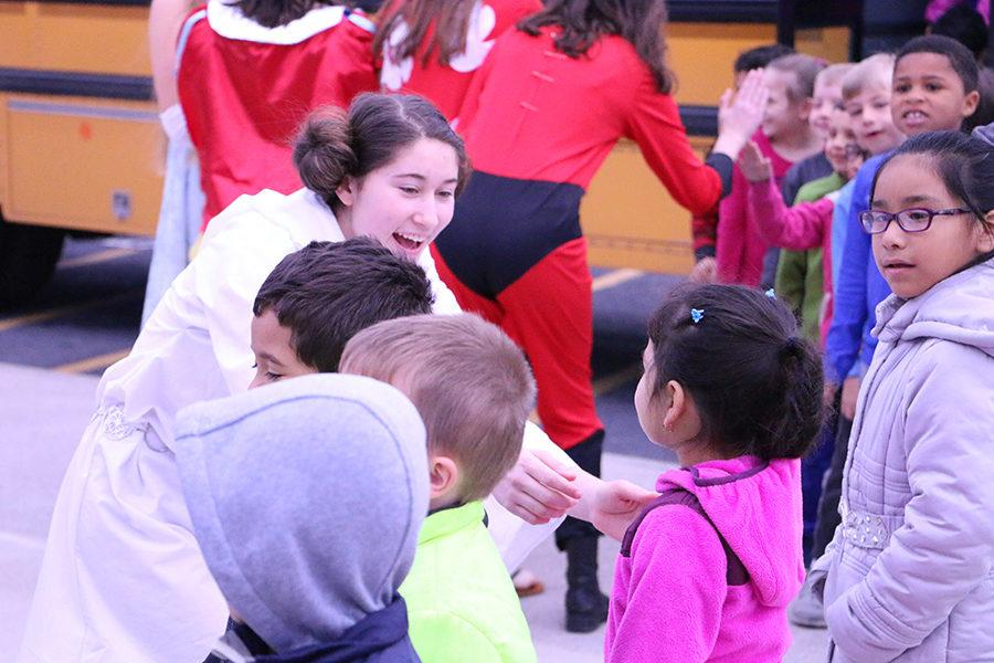 Junior Cary Hardwick welcomes Cub Run students dressed as Princess Leia from Star Wars.