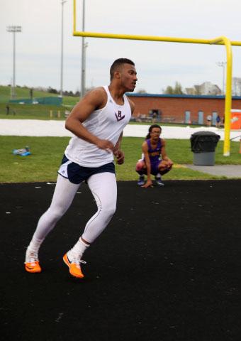 Junior+Collin+Morris+runs+up+to+do+his+high+jump+during+a+quad+meet+at+Harrisonburg+High.