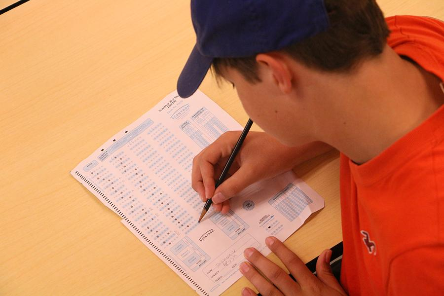 A student poses as they complete a Scantron, a method typically used in standardized testing, like AP exams