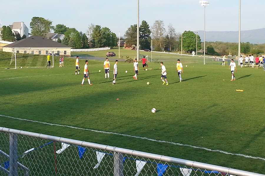 The boys soccer team warms up before their match